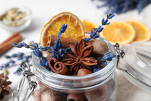 Aromatic Potpourri In Glass Jar On Table, Closeup