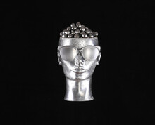 Silver Mannequin Head Isolated On Black Background