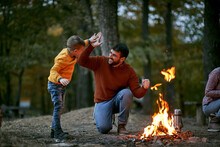Father With Son Giving Five