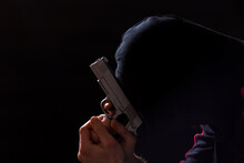 Man Praying With Gun. Street Crime. Encourage Crime. Gangster With A Pistol.