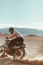 Motorcyclist Enjoying Stunts, Trona Pinnacles, California, US