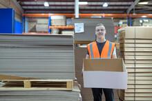 Portrait Of Worker In Cardboard Box Factory