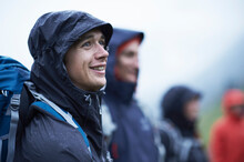 Young Male Hiker With Friends In Hooded Anoraks In Rain, Manigod, Rhone-Alpes, France