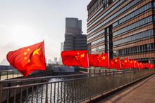 Row Of Chinese Flags On Huangpu River Promenade, Shanghai, China