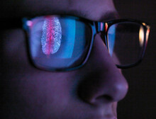 Cyber Security, Reflection In Spectacles  Of Access Information Being Scanned On Computer Screen, Close Up Of Face