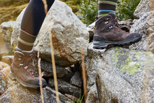 Female Hiker Stepping Onto Rock, Close Up Of Hiking Boots
