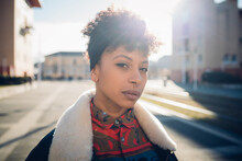 Cool Young Woman With Nose Piercing On Sunlit Urban Sidewalk, Head And Shoulder Portrait