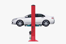 White Vehicle On Car Lift Side View