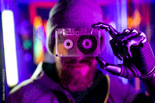 robotics man with metal hand nostalgia about past time in neon studio feeling lo Wallpaper Mural