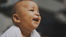 Portrait Of Adorable African American Black Baby. Baby Laughing While Having Tummy Time. High Quality Photo