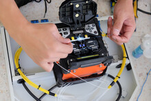Technicians Are Cutting And Fusion Fiber Optic Cables.
