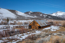Rustic Wooden Barn In The Eastern Sierra Nevada Mountains During Winter.
