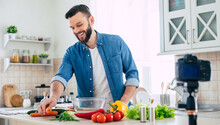 Real Man Kitchen Blog At Home While Guy Cooks Fresh Healthy Vegan Salad On The Camera
