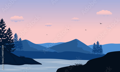 Fotografia Beautiful morning view from the river bank with mountains and trees around it