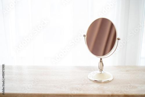 Valokuvatapetti Mirror on the table for beauty