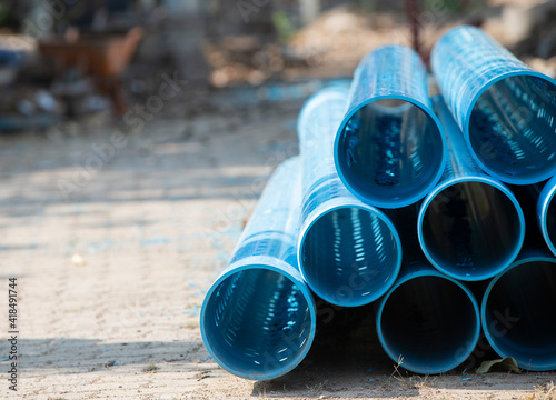 Canvas blue plastic pipes in construction site