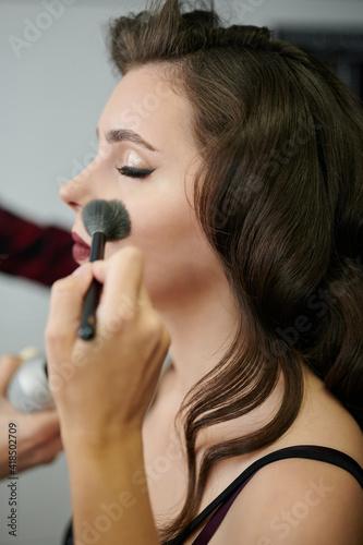 Applying cosmetic make up © PixieMe