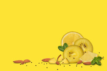 A Bright Yellow Background With An Added Composition Of Kiwi, Lemon, Mint, Almond Nuts, As Well As Kiwi Seeds
