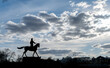 canvas print picture - A monument silhouette to Marshal Zhukov on a horse that stands in the center of Moscow by the Kremlin.