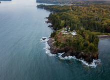 Owls Head Lighthouse  On The Rocky Cliffs On The Maine Coast In Autumn From An Aerial Drone Image