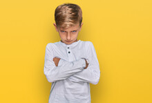 Little Caucasian Boy Kid Wearing Casual Clothes Skeptic And Nervous, Disapproving Expression On Face With Crossed Arms. Negative Person.
