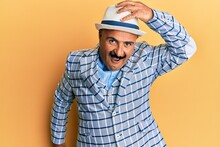 Mature Middle East Man With Mustache Wearing Vintage And Elegant Fashion Style Surprised With Hand On Head For Mistake, Remember Error. Forgot, Bad Memory Concept.