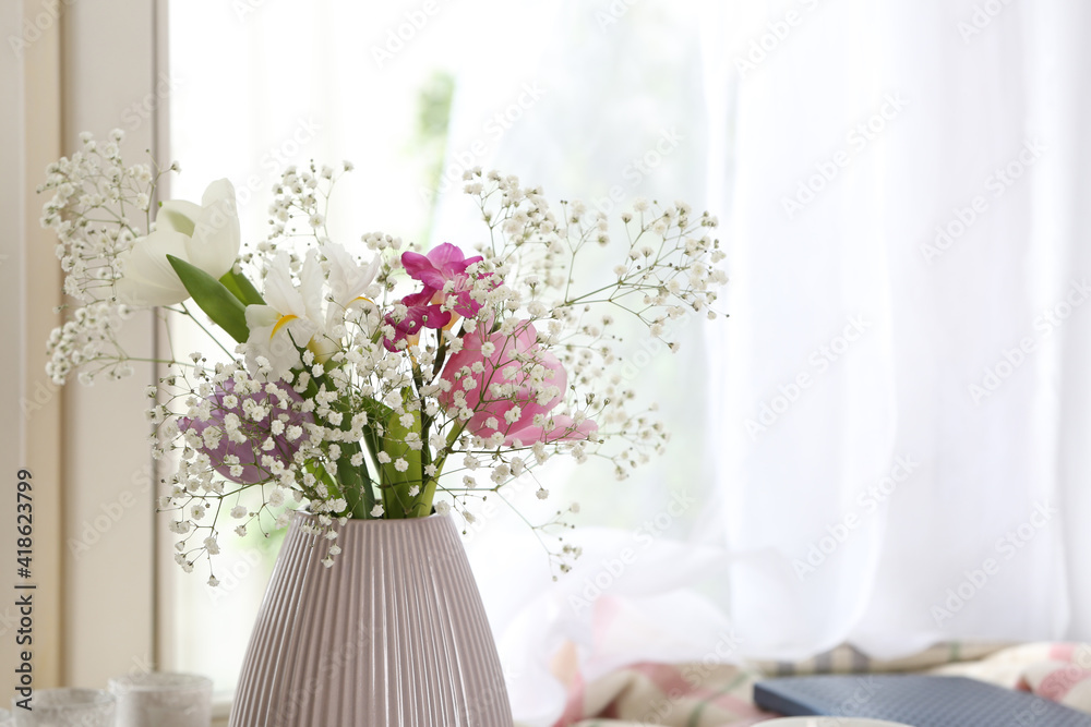 Fototapeta Beautiful fresh flowers near window indoors, closeup. Space for text