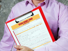 Business Concept Meaning USDA HOME LOAN Application Form With Inscription On Bank Form.