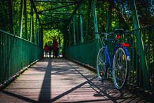 Picture Of Bicycles Leaning At A Bridge Railing In Hamburg, Germany