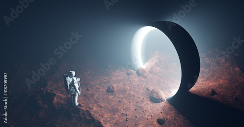 Fotografija Astronaut on foreign planet in front of spacetime portal light