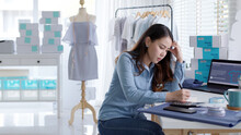 Young Attractive Asia Female Business Owner Thoughtful Serious Doubtful Feel Stress Worry With Financial Problem In SME Crisis Small Business Challenges Impact From Covid Coronavirus At Home Office.