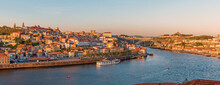Panoramic View On Porto City Center And The Douro River With Dom Luis Bridge In Portugal On Sunset