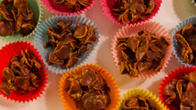 Full Frame Image Of Chocolate Crispy Cakes In Coloured Paper Cases