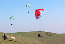 Paragliders Flying At Milk Hill, Wiltshire
