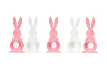 Five Wooden Easter Bunnies Of White And Pink Color Shown From Behind On A White Background