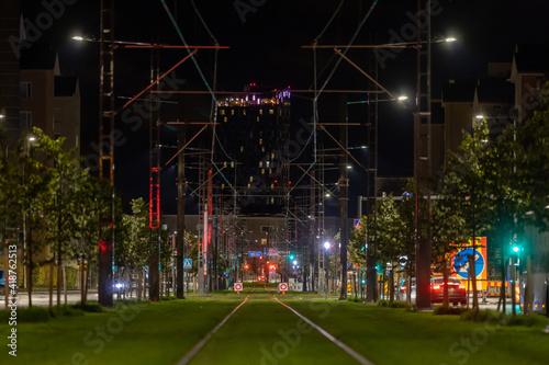 Fototapeta Tram rails on lawn in city center at night obraz na płótnie