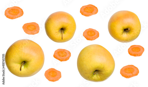 Canvas Golden delicious apples lying on their side with carrot slices isolated white background