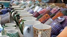 Ceramic Cups On A Market Table.