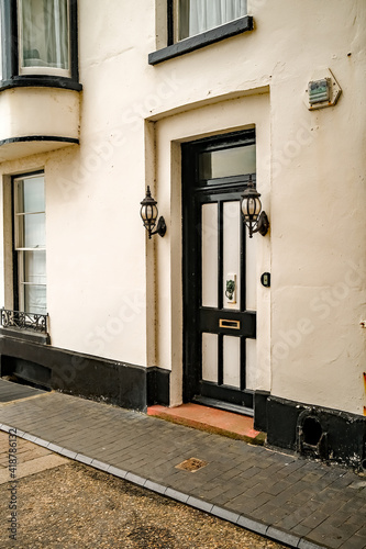 Ornate black door on a traditional Tudor style building in the seaside town of Cromer