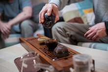 The Tea Master Teaches The Student The Art Of Brewing Tea According To Ancient Chinese Traditions On Bamboo Tray