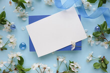 Postcard Mockup. Floral Frame Of Spring Flowers, Envelope And White Blank For Text