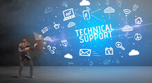 Businessman Defending With Umbrella From TECHNICAL SUPPORT Inscription, Modern Technology Concept