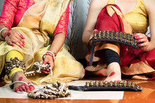 Indian Classical Girls Kathak Dancer In Traditional Dress Or Costume Tie Ghungroo Ghungru Or Noopura Which Is A Musical Anklet To The Feet Painted With Red Dye Altha Alah Mahavar Or Alta