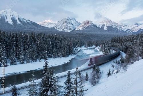 The Canadian Pacific Railway train whooshes by at Sunrise from Morants Curve Wallpaper Mural