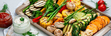 Grilled Assorted Vegetables In Beige Tray On Light Grey Background.