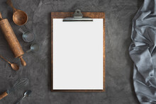 Menu Mockup With Knife And Fork On A Concrete Background, Free Space For Your Text