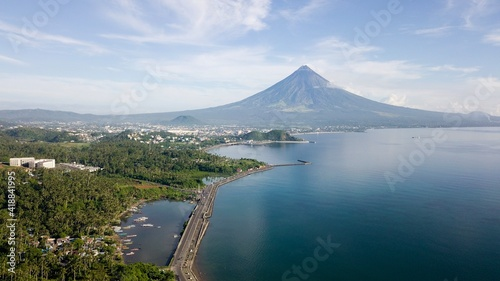 Canvas Print Drone shot of boulevard with Mayon Volcano