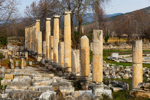 Remains of Ionic colonnades of South Agora amidst park in ancient Hellenistic ci Fotobehang