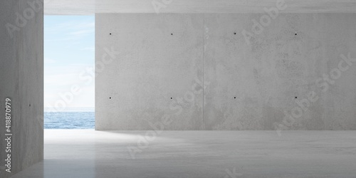 Fotografia Abstract empty, modern concrete room with opening with ocean view on the back wa