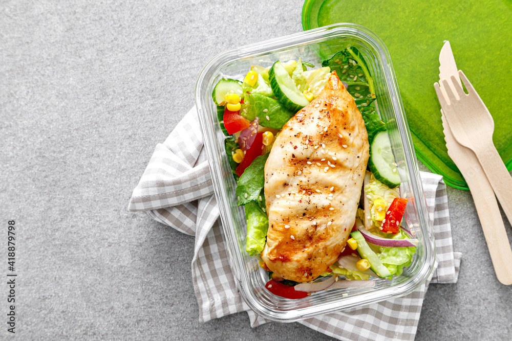 Fototapeta lunch box of vegetable salad with grilled chicken breast